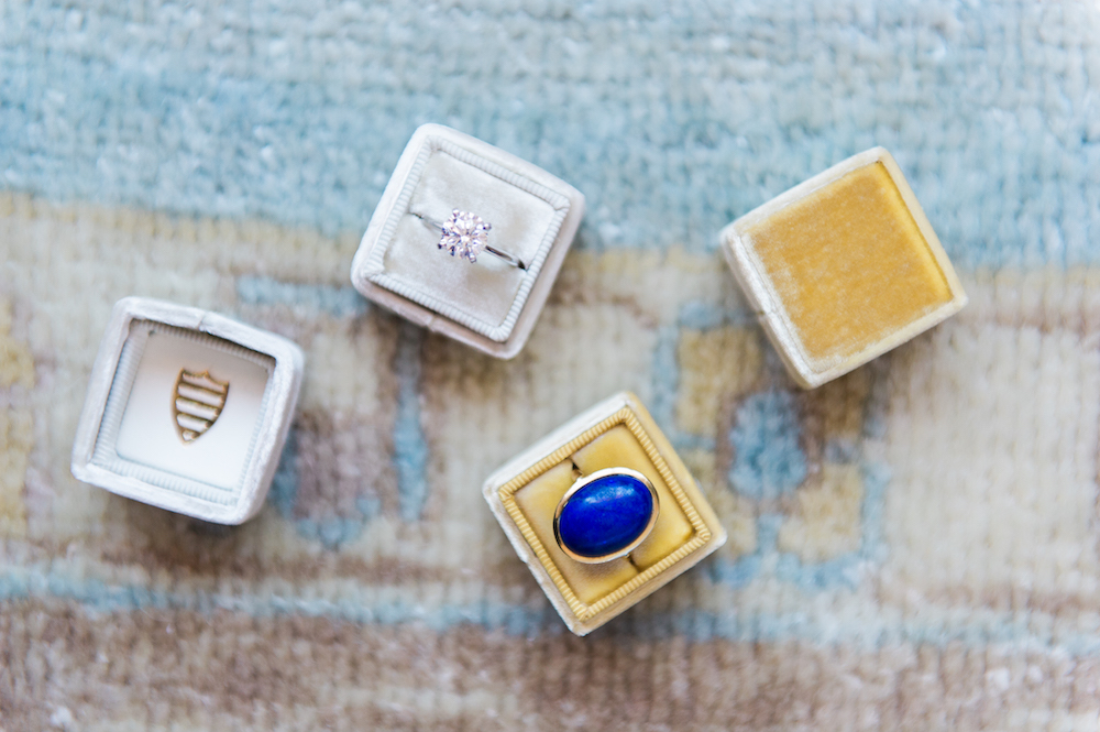 Mix of rings with one large Classic Blue: Color Of The Year stone