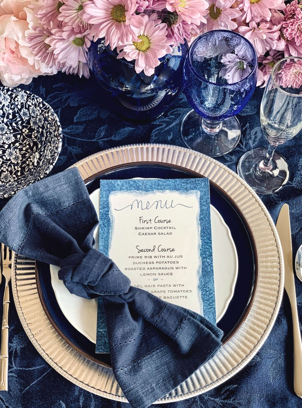 Up close shot of a table setting and menu in Classic Blue: Color Of The Year