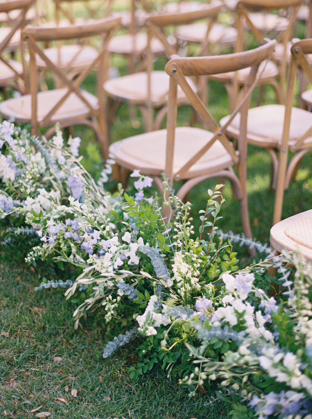 A mix of flowers outlining wedding seats in a light shade of Classic Blue: Color Of The Year