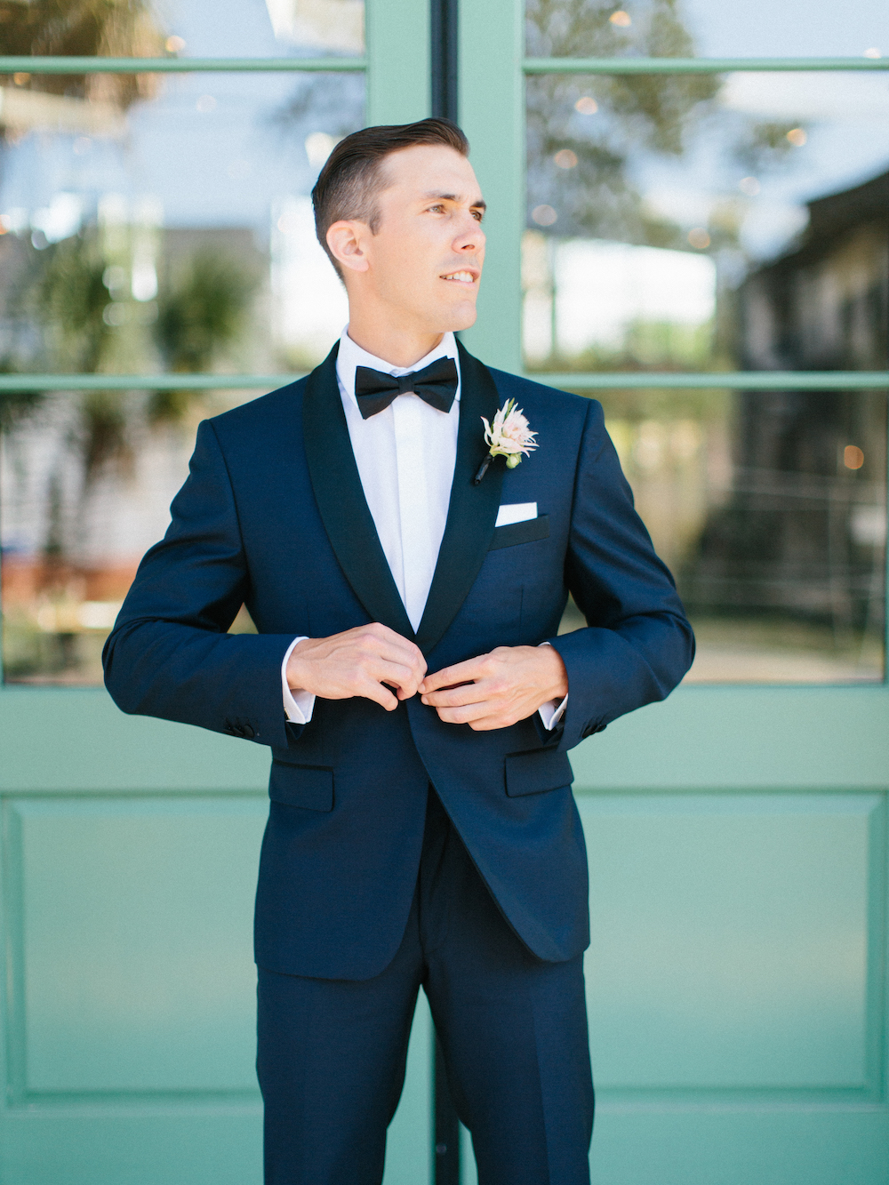 Man buttons his Classic Blue: Color Of The Year suit