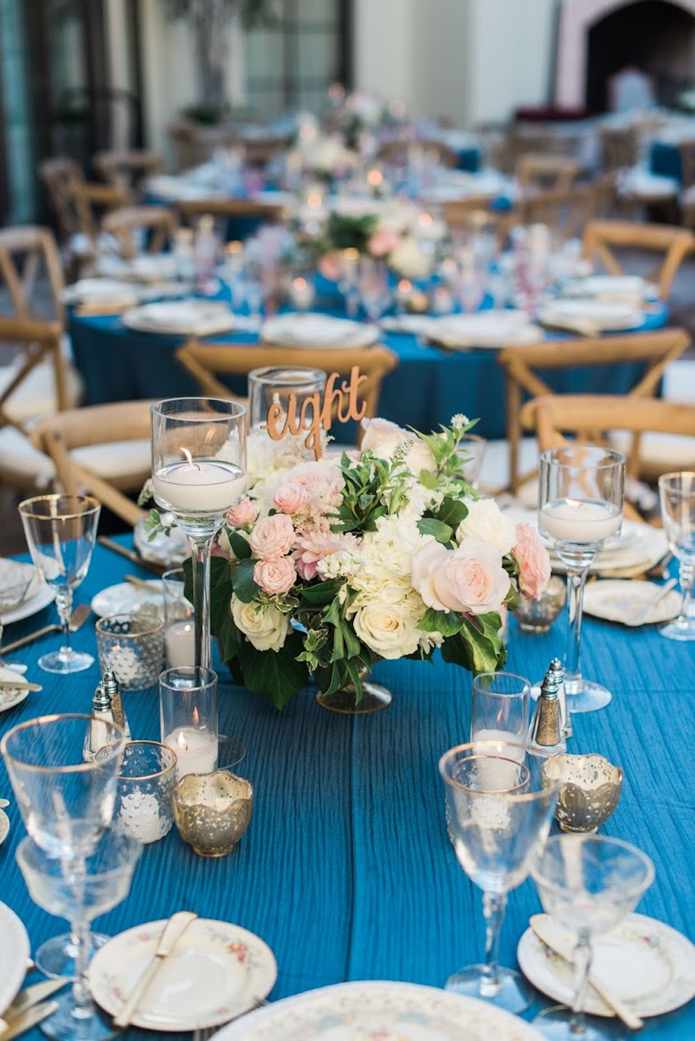 Simple white table seetings on a Classic Blue: Color Of The Year table cloth