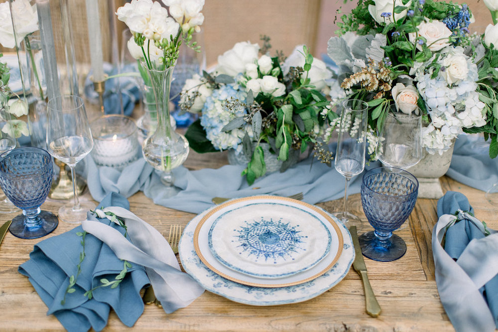 An ornate table setting featuring different shades of Classic Blue: Color Of The Year