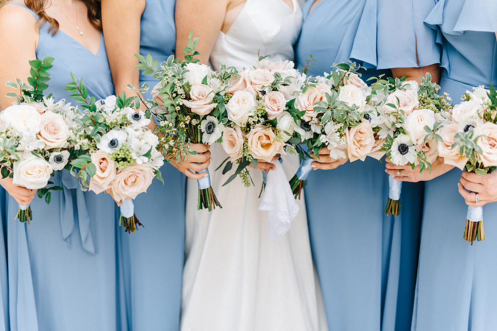 Bridesmaids in a light shade of Classic Blue: Color Of The Year dislaying their bouqets