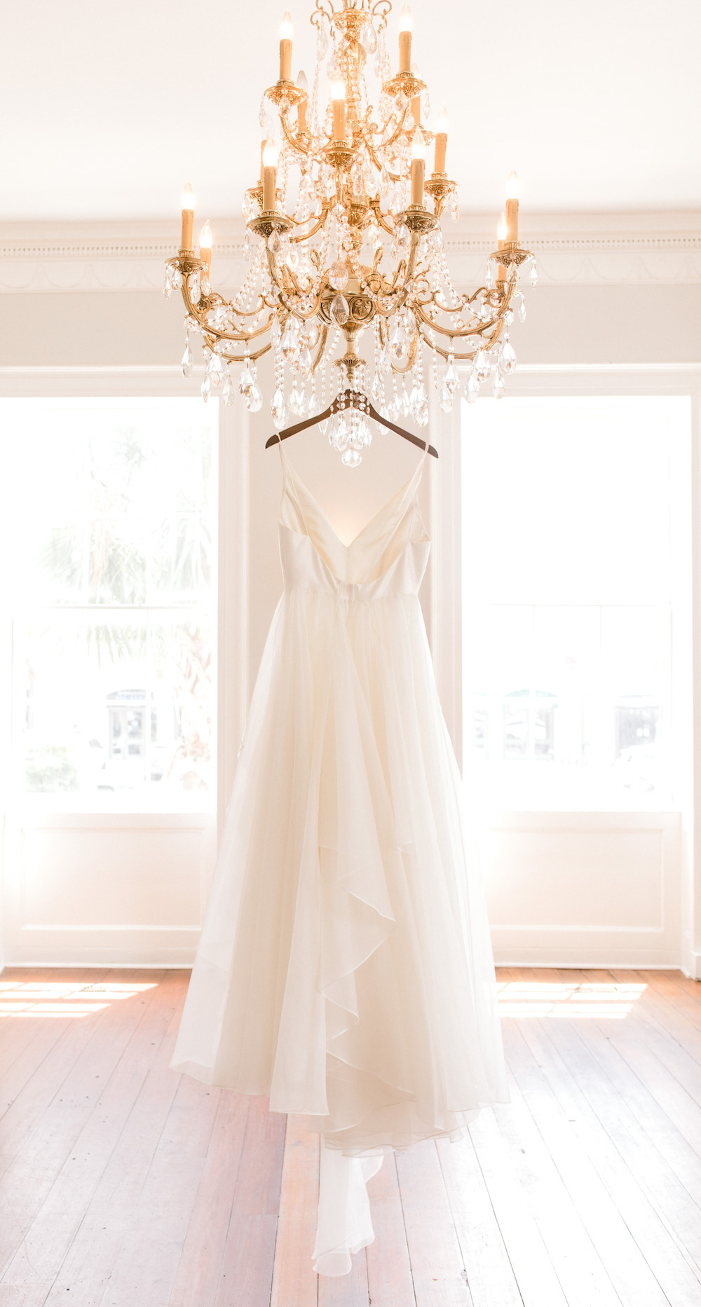Wedding Gown Hanging On A Southern Chandelier