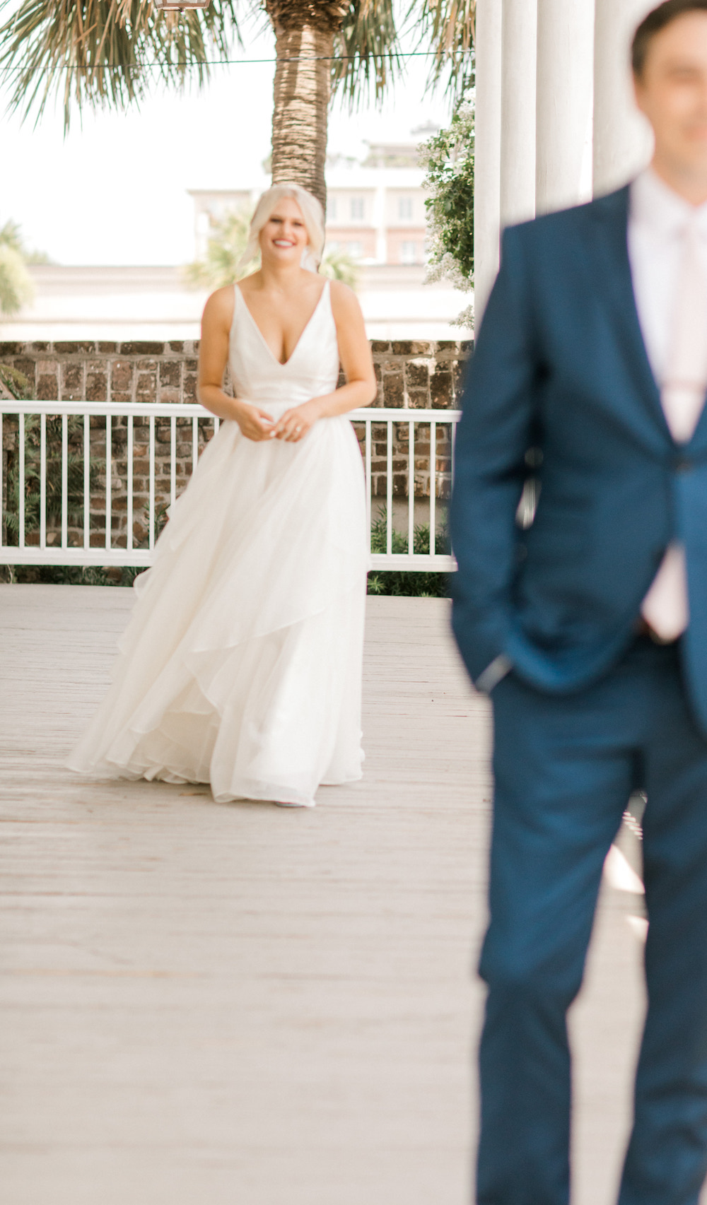Bride walking towards groom facing away