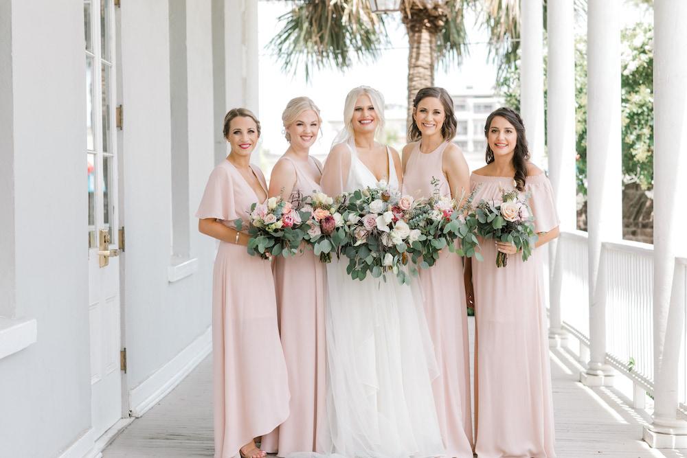Bride posing with her bridesmaids