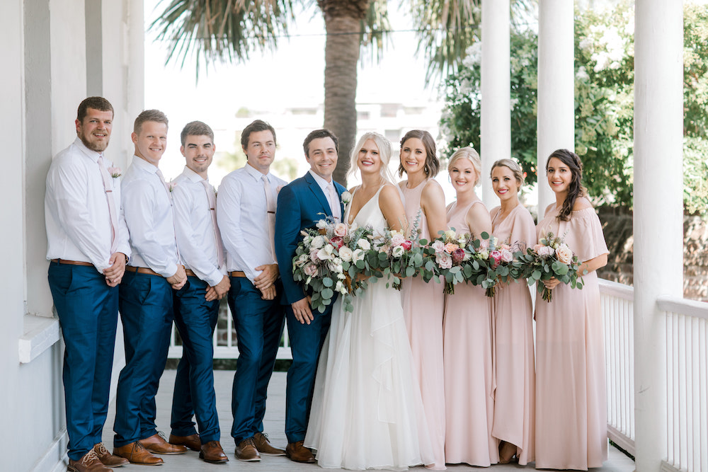 Full wedding party posing together