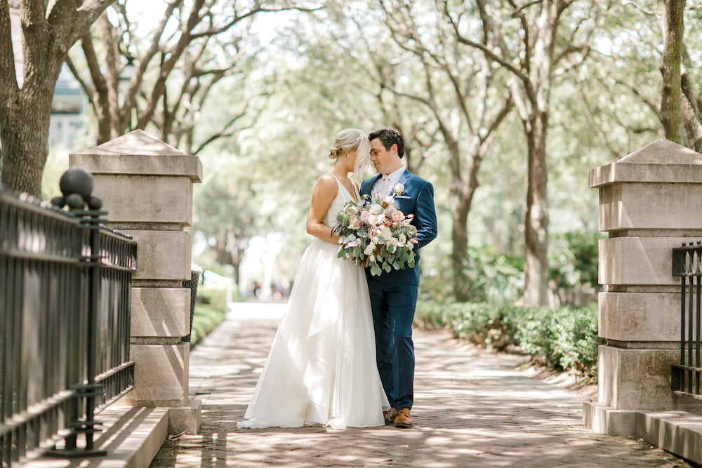 Bride and groom posing in a park