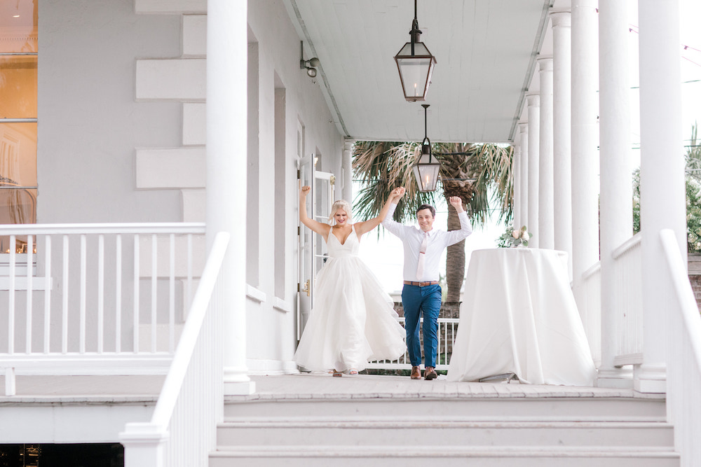 Bride and groom chearing on a porch